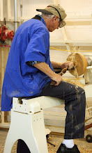 "Photo: He resumed hollowing the bowl with the tenon reversed in the scroll chuck, and left the tail center engaged for a while as a safety measure to permit some relatively aggressive cuts. After a while, he removed it and the resulting stub, and continued hollowing with the piece held in the chuck only. At that point, it became a case of ""ride 'em cowboy""."