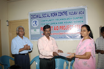 Photo: Certificate being awarded to a young woman