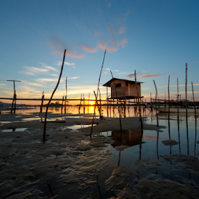 The boat house and a sunset by Härris McHörrör - Landscapes Sunsets & Sunrises ( reflection, old, colorful, silhouette, retro, ocean, travel, beauty, beach, jetty, landscape, pretty, people, dock, coast, boardwalk, sabah, sky, nature, pier, evening, light, water, clouds, orange, vintage, green, twilight, beautiful, sea, tourism, seascape, dusk, holiday, wooden, dawn, color, blue, sunset, background, summer, night, view, sunrise, scenery )