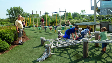 Photo: Obstacle course at the Wildlife Challenge exhibit - Grandpa watching Gen and Ethan climb the rope web.