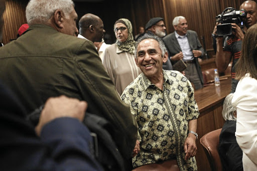 CLOSURE AT LAST Activist Ahmed Timol's brother, Mohammed, centre, is congratulated by Essop Pahad in the Pretoria High Court moments after the judge announced his finding that Ahmed Timol had been murdered by the apartheid police in 1971 and did not commit suicide as the police had claimed and a 1972 inquest had foundPicture: Alaister Russell