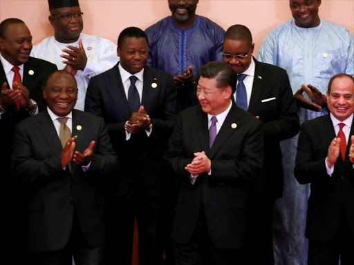 Chinese President Xi Jinping (front C), South African President Cyril Ramaphosa (front 3-L), Egyptian President Abdel Fattah al-Sisi (front R) and Kenya's President Uhuru Kenyatta (2nd row L) and other leaders during the Forum on China-Africa Cooperation in Beijing, China, September 3, 2018. / REUTERS