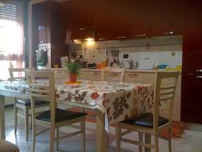 Photo: Kitchen & dining area. With Barry on the table.