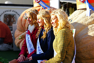 Photo: Cute queens pose by large pumpkins