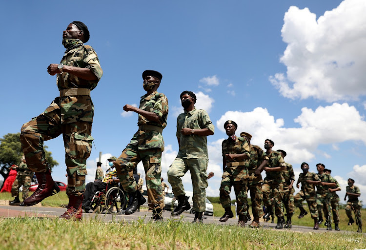 Military veterans outside former president Jacob Zuma's homestead in Nkandla on Thursday.