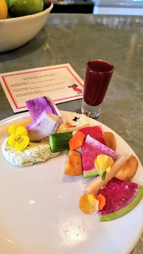 Guests were welcomed to the Kachka brunch celebrating Maslenitsa with a vitamin shot called Triple Sunrise with horseradish vodka, apple juice, beet juice, and celery bitters, and then given a crudite plate with dill butter