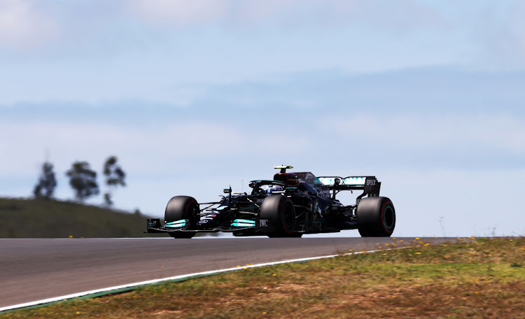 Valtteri Bottas of Finland driving the (77) Mercedes AMG Petronas F1 Team Mercedes W12 on track during qualifying for the F1 Grand Prix of Portugal at Autodromo Internacional Do Algarve on May 01, 2021 in Portimao, Portugal.