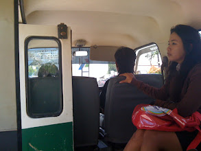 Photo: Luxury interior of angkot - rickety seats, no seat belts and the door is always open.