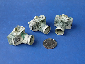 Photo: Model: Dollar Camera;  My 1st, 2nd, and 3rd attempts at folding the camera;  Creator: Won Park;  Folder: William Sattler;  1 dollar each;  Source: moneyfolders_unite Yahoo group http://groups.yahoo.com/group/moneyfolders_unite/