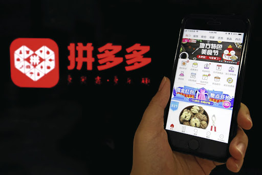 ONLINE ECONOMICS: Chinese online discounter Pinduoduo, a Facebook-Groupon mash-up, is challenging Alibaba and JD.com. Picture: REUTERS