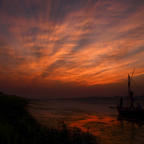 ...the promise of a golden tomorrow by Rohit Chawla - Landscapes Sunsets & Sunrises ( ganga, fishermen, nature, allahabad, sunset, cosurvivor, india, boat, golden hours, confluence, yamuna, river )