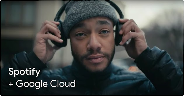 Spotify and Google Cloud text over image of customer holding headphones