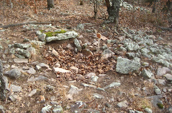 Photo: Cairn #H, which is disturbed to below grade level. #G is in the background