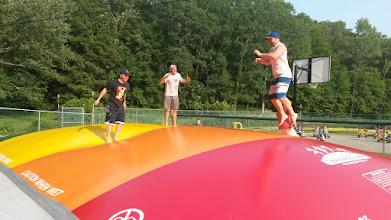 Photo: Adults enjoying Jumping Pillow