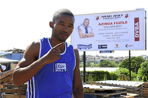 "Azinga Fuzile looks confident ahead of his title fight against current ABU featherweight champion Nigerian Waidi ""Skoro"" Usman, on Sunday. / SIBONGILE NGALWA"