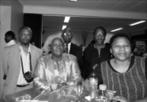 REMEBER: Members of the Goniwe family and close friends. Front row: Ntsiki Biko, wife of Black Consciousness leader Steve Biko, and Nyameka Goniwe, widow of Matthew Goniwe. 05/11/08. © Unknown.
