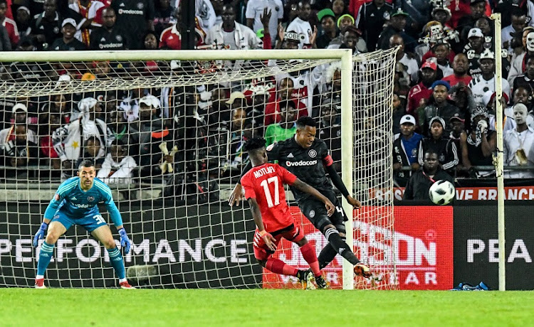 Captain Happy Jele of Orlando Pirates defends against Thabo Motlafi of Highlands Park during the Absa Premiership match between Orlando Pirates and Highlands Park at Orlando Stadium on August 04, 2018 in Johannesburg, South Africa.