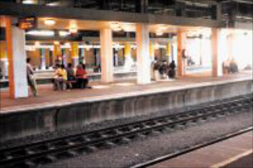 WAITING SPIRIT: Commuters were left stranded at Durban station as Metrorail workers went on strike. Pic. THULI DLAMINI. 17/08/2009. © Sowetan.