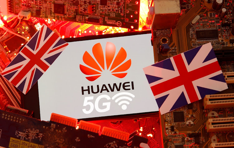 The British flag and a smartphone with a Huawei and 5G network logo. Picture: REUTERS/DADO RUVIC