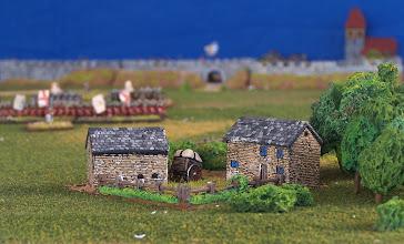 Photo: I Piani di Abramo visti da sud-ovest, sullo sfondo le mura della città di Quebec.Miniature Baccus, materiale scenico TimeCast e autocostruito.