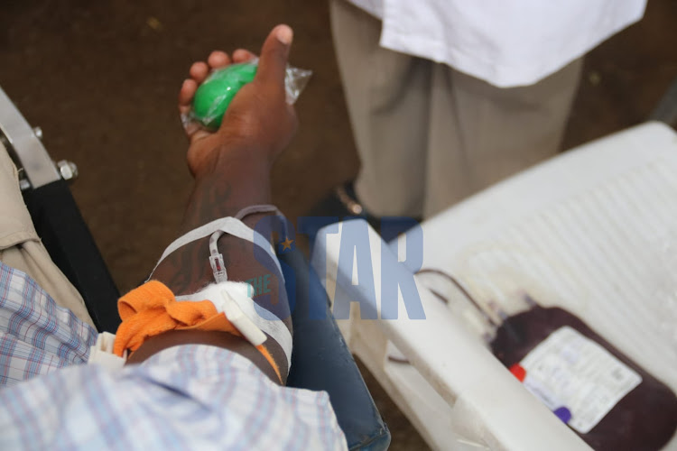 A man donates blood during an exercise held by Kenya National Blood Transfusion Service in partnership with the coalition for blood Africa (CoBA) at Uhuru Park Nairobi on Monday, 8 March. /WILFRED NYANGARESI
