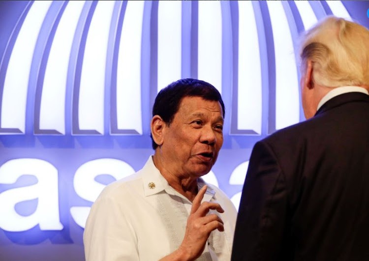 Philippine President Rodrigo Duterte (L) gestures to US President Donald J. Trump (R) before the opening ceremony of the 31st Association of Southeast Asian Nations (ASEAN) Summit in Manila, Philippines,13 November 2017.