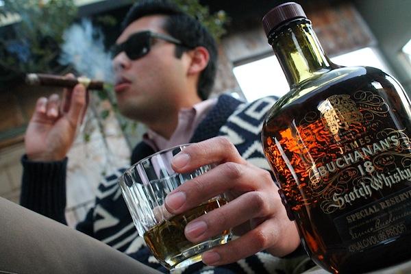 6. Drinking a straight up scotch.