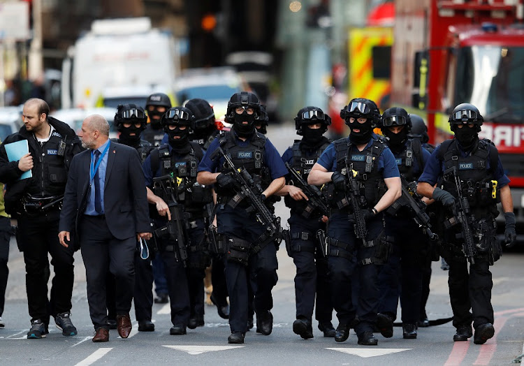 Armed police officers walk outside Borough Market after an attack left 6 people dead and dozens injured in London, Britain, on June 4 2017. Picture: REUTERS