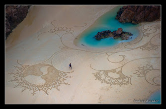 Photo: U.S artist Andres Amador walks through his creation on Plemont beach for the MyMemory.com World Beach Art Championships in Jersey, Channel Islands on October, 30, 2011. Photographer: Carl Court.
