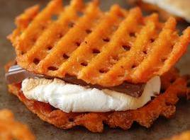 Top toasted marshmallows with chocolate and top with remaining waffle fries. Gently press until...