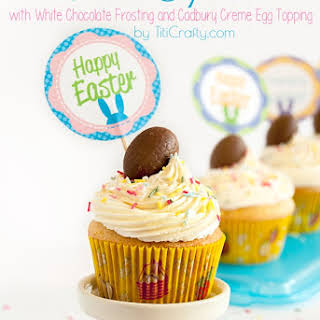 Almond Cupcakes with White Chocolate Frosting and Cadbury Creme Egg Topping.