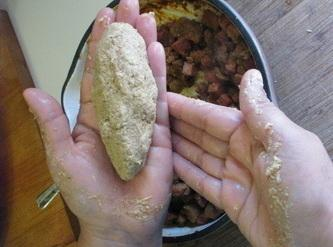 Spread about 1/4 cup of the alcapurria dough onto your hand, wax paper or...