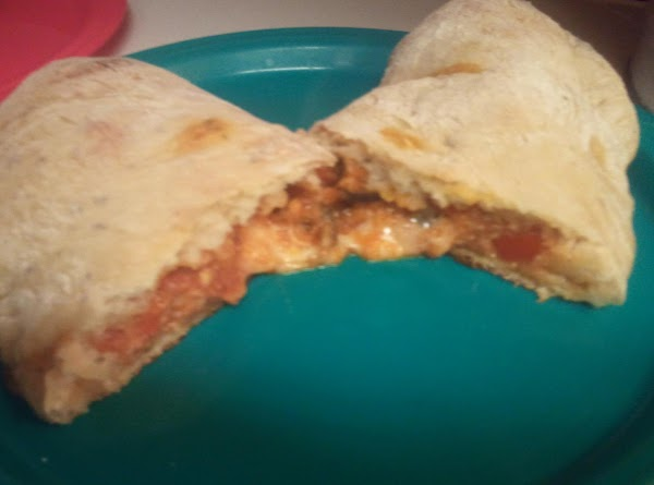 Place each calzone on greased baking sheet and cut 3 small slits in each...