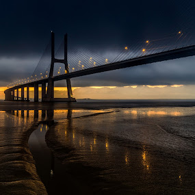 Follow the light ! by Emanuel Fernandes - Buildings & Architecture Bridges & Suspended Structures ( clouds, water, vasco, ponte, gama, sunset, sunrise, bridge, portugal, ligh )