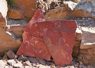Photo: The natural vertical cracks in the quartzite carry down through the pipestone which allows the quarrier to remove the pipestone layers in irregularly-shaped slabs. (2016 photo)