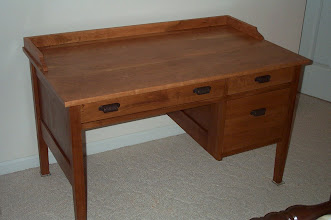 Photo: Cherry desk.  I made this desk for my wife, Christie.  I patterned it after an antique desk her mother owns.  48 inches wide, 29 inches deep, and 29 inches high.