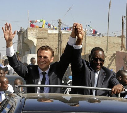 French President Emmanuel Macron (left) and Senegalese President Macky Sall wave in Saint-Louis, Senegal. Macron has emphasised the importance of building cultural exchanges in Africa. Picture: REUTERS