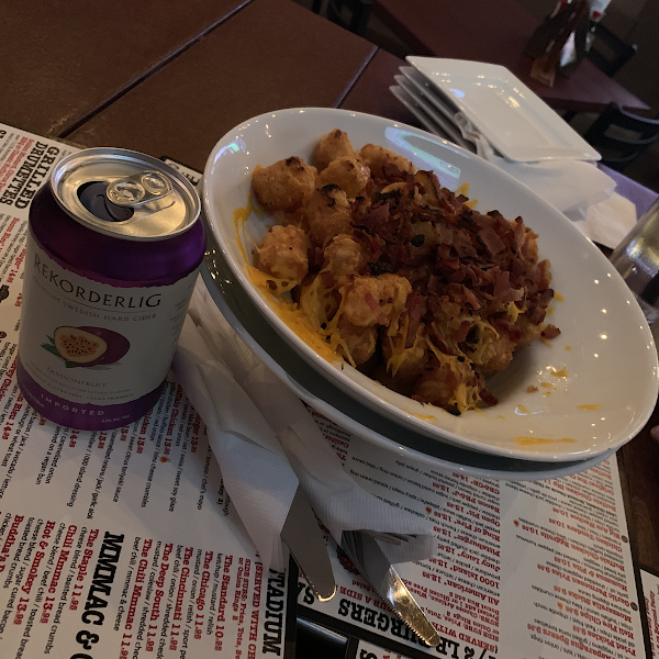 Gf tots with cheese and bacon- looks a little messy because I couldn't wait to dive in! Then thought about taking the picture. The passion fruit cider was so good too!