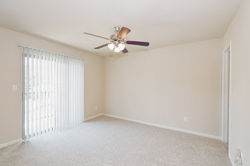 Dogwood bedroom with balcony door, ceiling fan, and carpet