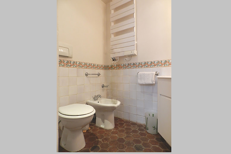 Toilet at 2 bedroom Apartment with St Germain Views