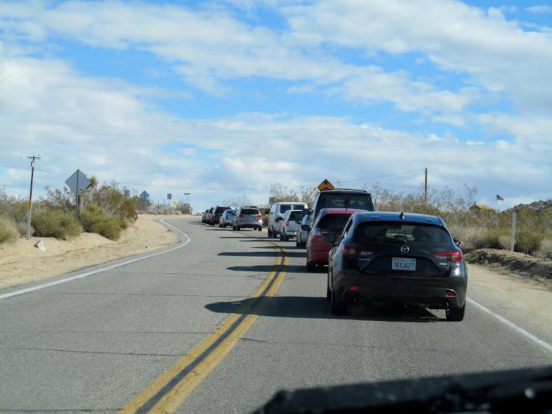 Photo: Cars backed up at the entrance to Joshua Tree