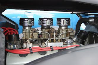 Photo: Side of hemi engine with distributor and three carburetors