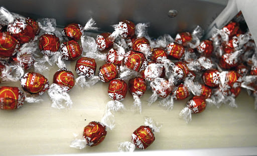 Lindor chocolates are seen on a conveyor belt during production at the plant of Swiss chocolate maker Lindt & Sprungli in Kilchberg, Switzerland. Picture: Reuters