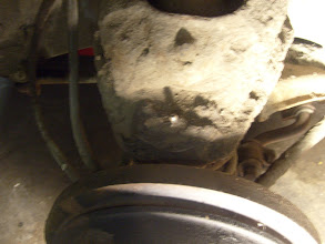Photo: Driver's side suspension shows years & miles of use. This car was meant to be on the road!!