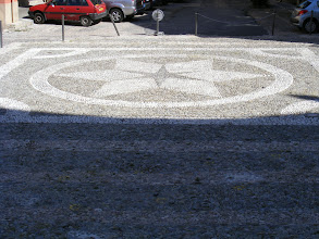 Photo: The square in front of the church is paved with designs in white and gray stones.
