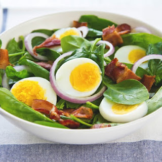 Wilted Spinach Salad With Warm Bacon Dressing.