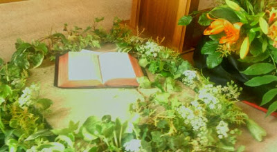 Photo: a bible wreathed in blooms, part of the Wesleyian Jubilee Flowershow.