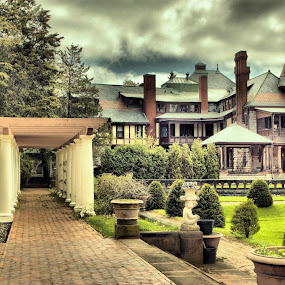 SOnnenburg Gardens Mansion by Jim Davis - Buildings & Architecture Public & Historical ( brick walkway, portcullis, building, red, mansion, green, gardens, trees, dark overcast sky, historical, architecture )