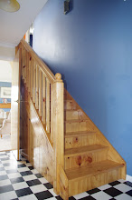 Photo: Staircase up to two bedrooms and a study space