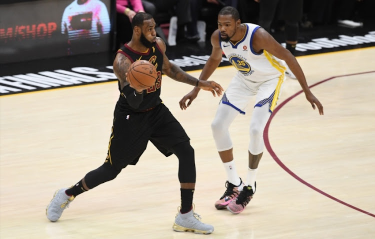 LeBron James #23 of the Cleveland Cavaliers controls the ball against Kevin Durant #35 of the Golden State Warriors during Game Three of the 2018 NBA Finals at Quicken Loans Arena on June 6, 2018 in Cleveland, Ohio.